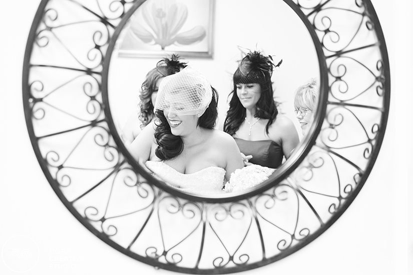 Our gorgeous bride is helped by the various, loving women in her life on her wedding day