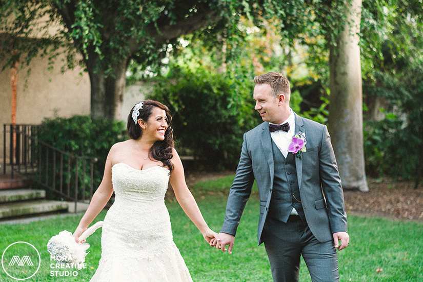 Our couple shares special moments during their portraits outside before their elegant wedding ceremony at the Los Angeles River Center and Garden taken by the photographers of Mora Creative Studio