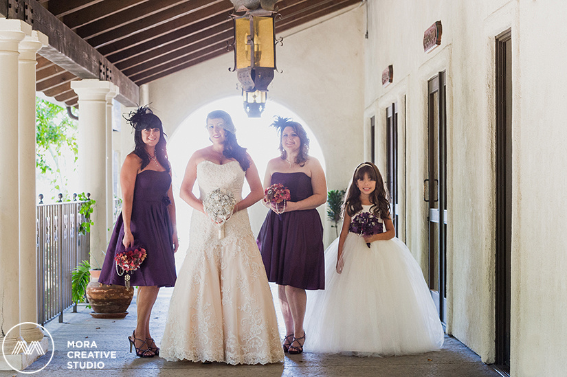 Our gorgeous bride Laura takes a photo with her beautiful bridesmaids and cute flower girl before her wedding ceremony at the Los Angeles River Center and Garden